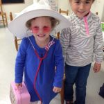 two children playing dress up